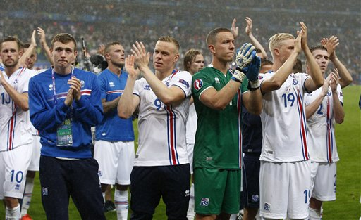 Iceland's players applauds supporters at the end of the Euro 2016 quarterfinal soccer match between France and Iceland, at the Stade de France in Saint-Denis, north of Paris, France, Sunday, July 3, 2016. France won 5-2. (AP Photo/Thibault Camus)
